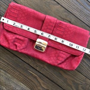 Express red clutch with gold buckle